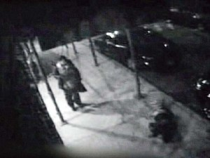 CCTV Still from NY of man lying on floor as someone walks past